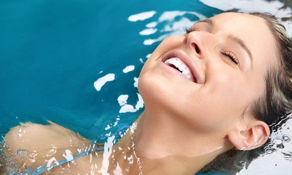 Woman relaxing in Fresh Water by Caldera Spas